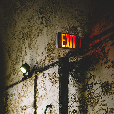 Exit sign on the wall of a building